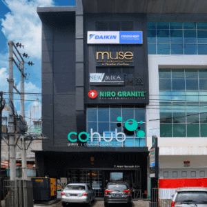 The Front Side of Cohub Indonesia Bulding with Cohub Indonesia, Niro Granite, New Mika, Muse Cabintery and Daikin Proshop Billboard