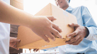 A person handing another person a package